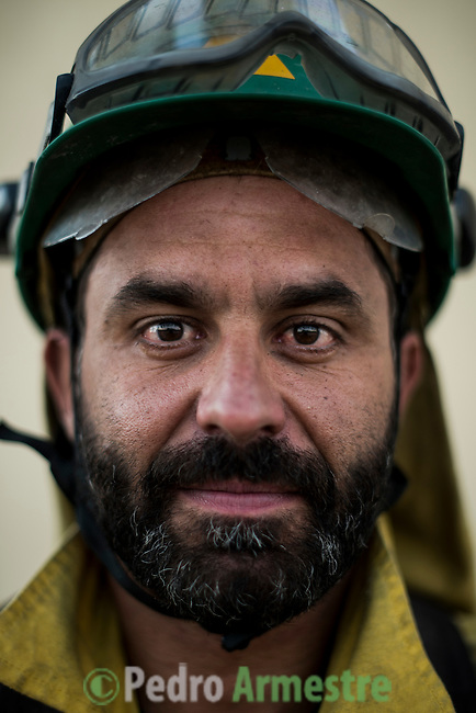 Antonio Muñoz Martín. The firefighter from the BRICA Málaga 703, the Andalusian Service firefighting (INFOCA),  posses after a wildfire in Los Barrios near Cadiz on July 25, 2015. © Pedro ARMESTRE