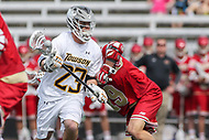 Towson, MD - March 25, 2017: Towson Tigers Tyler Young (23) fights off a Denver Pioneers defender during game between Towson and Denver at  Minnegan Field at Johnny Unitas Stadium  in Towson, MD. March 25, 2017.  (Photo by Elliott Brown/Media Images International)