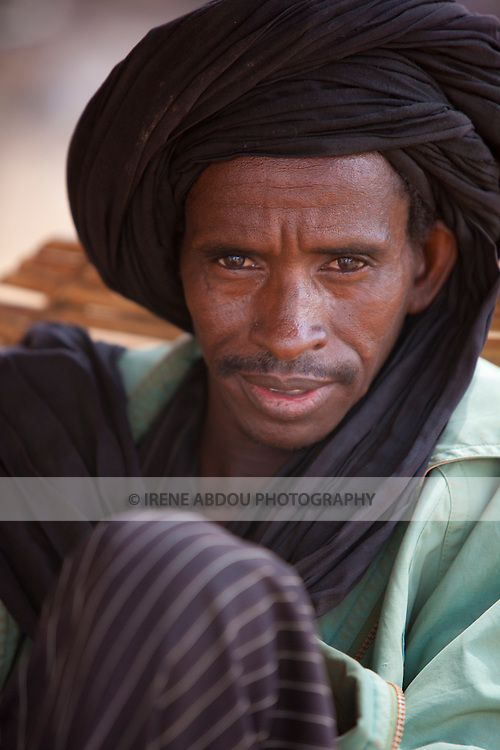 In Djibo in northern Burkina Faso, a man wears a turban in traditional Fulani fashion.  For these nomadic pastoralists, the turban protects against dust kicked up by livestock and the harsh Harmattan winds.