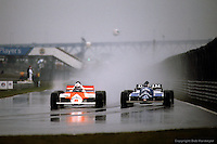MONTREAL, QUEBEC - SEPTEMBER 27: Andrea de Cesaris #8  McLaren MP4-1 01/Ford Cosworth drives anlongside Jean-Pierre Jarier #32 Osella FA1C 001/Ford Cosworth during the Canadian Grand Prix on September 27, 1981, at the Circuit Île Notre-Dame in Montreal, Quebec.