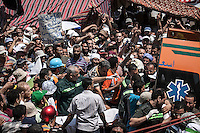 In this Saturday, Jul. 27, 2013 photo, a dead body is being transfer from the field hospital as supporters of the ousted president Mohammed Morsi mourn the dead body after it was killed by police forces during a faighting in the nearby streets of Rabaa Al-Alawya mosque in the Nasr City neigbourhood of Cairo. (Photo/Narciso Contreras).