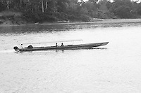 Motorized canoe on Rio Napo in jungle of eastern Ecuador.