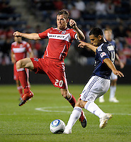 Chicago forward Brian McBride (20) attempts to block a kick by Chivas defender Michael Umana (4).  The Chicago Fire tied Chivas USA 1-1 at Toyota Park in Bridgeview, IL on May 1, 2010.