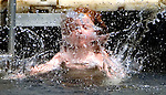 WATERTOWN CT. 10 July 2015-071015SV04-Bunny Wesson, 4, of Watertown jumps off the dock at Sylvan Lake Park in Watertown Friday. She was there with her sister and grandmother enjoy in the warm summer day.  <br /> Steven Valenti Republican-American