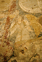 Fresco on the top head of the 34 meters Bamiyan Buddha..The parabolic niche in which this figure stands was once covered with paintings but most have fallen except for the heroic figure of the Sun God riding in his golden chariot pulled through a dark-blue sky by snow-white horses, which can still be seen on the soffit of the niche..The scene conceptualizes the relationship between the cosmos and the Buddha who is represented below as the embodiment of a Cosmic Buddha evolving from the sun in order to illuminate the world with total understanding. The iconography is syncretic, combining symbolism from Greece (Helios), Sasanian Persia (Mithra) and India (Surya). The Sun God is dressed in a long Sasanian cloak with a sword attached to the belt and he carries a scepter. This central figure is framed in a dark-red saw-toothed nimbus and the chariot with its riders bursts through the clouds. Above the nimbus there are flying geese and two truncated busts of women wearing pointed caps and holding billowing scarves over their heads. They represent the breezes which rise at sunrise and sunset. On either side of the Sun God there are two half-bird, half-human sirens, representing the deities who direct celestial music. Below them there are two winged female figures wearing helmets, each holding a shield and a spear. These may be seen as Night and Dawn, Mithras handmaidens, as Nike Athene, or as the wives of Surya.