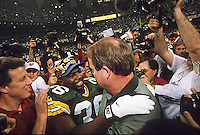 Green Bay Packers defensive back LeRoy Butler and coach Mike Holmgren embrace after the Green Bay Packers defeated the New England Patriots 35-21 in Super Bowl XXXI in the Superdome in New Orleans on January 26, 1997.