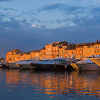 Large yachts moored in harbour at sunset, Saint Tropez, France