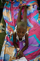 A young cholera patient rests at the Hospital Albert Schweitzer on Saturday, October 30, 2010 in Deschapelles, Haiti.