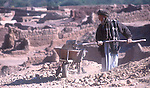 At the Shamshatoo refugee camp near Peshawar, a man works on building a house...