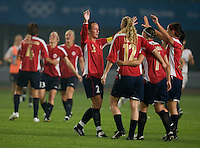 Norwegian captain (2) Ane Stangeland embraces her teammates after their first round game in the 2008 Beijing Olympics in Qinhuangdao, China. .  The US lost to Norway, 2-0, at Qinhuangdao Stadium.