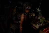 Filipino man at a market in Manila, Philippines..**For more information contact Kevin German at kevin@kevingerman.com