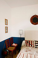 A detail of the blue room with its hand-painted Fanni Chambas bed covers