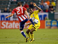 Chivas USA midfielder Ben Zemanski (21) passes off the ball past Columbus Crew's Emmanuel Ekpo (17). CD Chivas USA defeated the Columbus Crew 3-1 at Home Depot Center stadium in Carson, California on Saturday July 31, 2010.