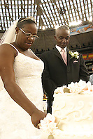 Bride Rebecca Warren with her groom Joseph Smothers after they were married in the Houston Astrodome, a shelter for hurricane Katrina evacuees in 2005.