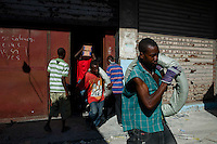 Port Au Prince, Haiti, Jan 23 2010.Workers emptying a warehouse full of goods under the supervision from the owner as well as the police..