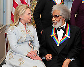 Sonny Rollins, on of the recipients of the 2011 Kennedy Center Honors, shares some thoughts with United States Secretary of State Hillary Rodham Clinton, as they prepare to pose for a photo following a dinner hosted by United States Secretary of State Hillary Rodham Clinton at the U.S. Department of State in Washington, D.C. on Saturday, December 3, 2011. The 2011 honorees are actress Meryl Streep, singer Neil Diamond, actress Barbara Cook, musician Yo-Yo Ma, and musician Sonny Rollins..Credit: Ron Sachs / CNP
