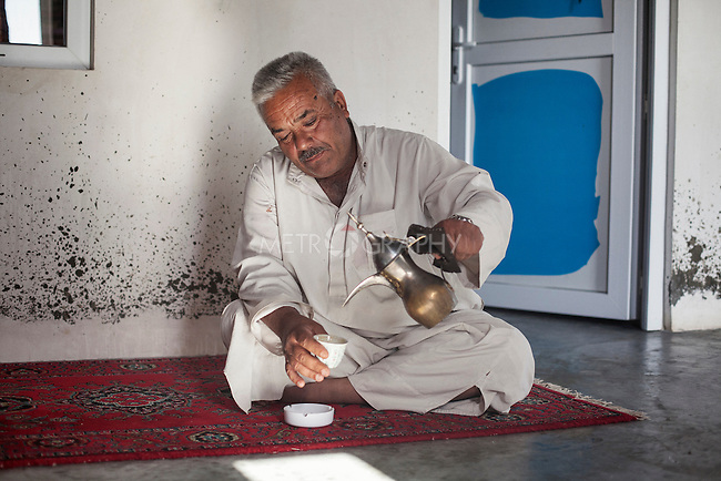 16/05/15. Awbar Village, Darbandikhan area, Iraq. -- Najm pours some arabic coffee during a break in the afternoon.