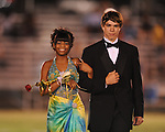 Junior maid Santania Hairston (left) is escorted by Brooks Hillhouse during Lafayette High vs. Byhalia in homecoming football action in Oxford, Miss. on Friday, September 24, 2010.