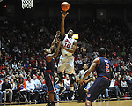 "Ole Miss' LaDarius White (10) shoots over Auburn guard Josh Wallace (11) at the C.M. ""Tad"" Smith Coliseum on Saturday, February 23, 2013. Mississippi won 88-55."