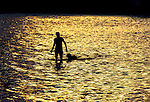 A woman wades with her dog in the shallow water at Shell Point Beach.