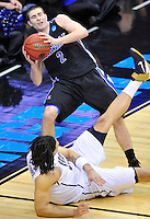 Matt Dickey of the Bulldogs is fouled by Panthers' Gary McGhee. Pittsburgh defeated UNC-Asheville 74-51 during the NCAA tournament at the Verizon Center in Washington, D.C. on Thursday, March 17, 2011. Alan P. Santos/DC Sports Box