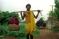 The village of Padmakesharpur in the state of Orissa in East India is probably the largest community of snake charmers anywhere in the world. 200 charmers live in the village, but each year they find it harder to make a living from charming and their numbers are slowly diminshing. A charmer can be seen returning from his travels which can last several weeks. The baskets contain the snakes, the largest basket contains a Rock Python.
