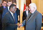The Rev. Frank Chikane (left) of South Africa greets Iraqi President Fuad Masum on January 22, 2017, during the visit of a high-level ecumenical delegation to Baghdad.