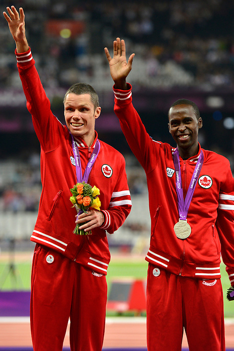 LONDON, ENGLAND 07/09/2012 - Jason Joseph Dunkerley and his guide Joshua Karanja receive the Silver Medal in the Men's 5000m T11 final at the London 2012 Paralympic Games in the Olympic Stadium. (Photo: Phillip MacCallum/Canadian Paralympic Committee)