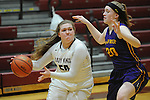 Ketchikan's Payton Simmons gets a pass away against the defense of Lathrop's Olivia Kraska in their Dimond Lady Lynx Prep Shootout basketball game Friday, February 10, 2017.  Photo for the Daily News by Michael Dinneen