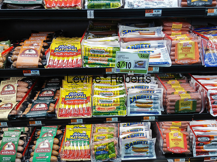 Packages of various brands of hot dogs are seen in a supermarket cooler in New York on Monday, April 4, 2016. (© Richard B. Levine)