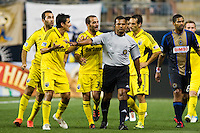 Justin Meram (9), Milovan Mirosevic (10), Federico Higuain (33) and Sebastian Miranda (21) of the Columbus Crew argue with referee Yader Reyes. The Columbus Crew defeated the Philadelphia Union 2-1 during a Major League Soccer (MLS) match at PPL Park in Chester, PA, on August 29, 2012.