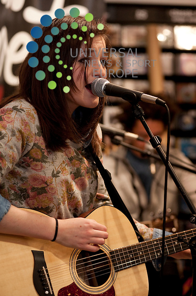 Pearl aka Katie Sutherland of Pearl and the Puppets play the FOPP music store on Glasgow's Union Street to a small crowd of fans and some lucky shoppers...Fopp, Union Street, Scotland. Picture: Euan Anderson/Universal News And Sport (Scotland) 4th May 2010.
