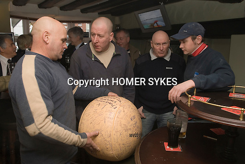 Shrove Tuesday Football. Atherstone Warwickshire UK 2008.Committee members at The Angel Inn with signed football before the start of the annual game.