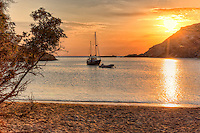 Sunset at Fellos beach in Andros island, Greece