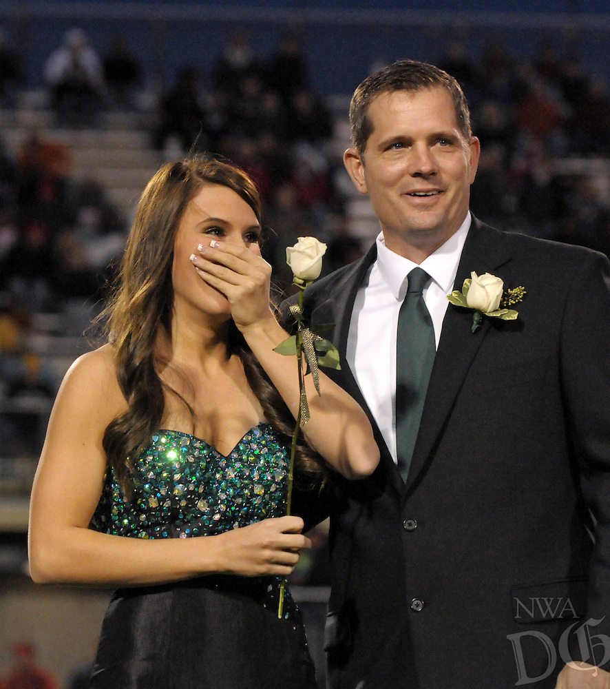 STAFF PHOTO BEN GOFF  @NWABenGoff -- 10/03/14 Rachel Ronan, 17, and her father Marc Ronan react as she is announced as the 2014 Bentonville High School homecoming queen during homecoming festivities before the football game against Fort Smith Northside in Bentonville's Tiger Stadium on Friday October 3, 2014.
