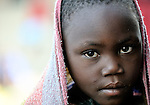 A girl displaced by fighting between forces of rebel Tutsi General Laurent Nkunda and the Congolese government took refuge in a church and adjacent school in the Goma neighborhood of Musawato. A quarter of a million people have been newly displaced by fighting in the eastern Congo, where some 5.4 million have died since 1998 from war-related violence, hunger and disease.