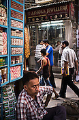 Pedestrians walk past a jewellery store in Dariba Kalan in Old Delhi, India. Photo: Sanjit Das/Panos Pictures