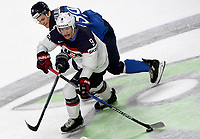 American Andrew Copp (front) and Finland's Jesse Puljujarvi fight for the puck during the Ice Hockey World Championship quarter-final match between the US and Final in the Lanxess Arena in Cologne, Germany, 18 May 2017. Photo: Monika Skolimowska/dpa /MediaPunch ***FOR USA ONLY***