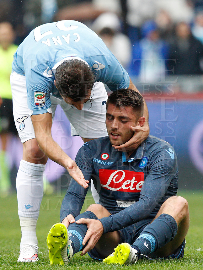 Calcio, Serie A: Lazio vs Napoli. Roma, stadio Olimpico, 18 gennaio 2015.<br /> Napoli&rsquo;s David Lopez Silva is comforted by Lazio&rsquo;s Lorik Cana, left, after being injured during the Italian Serie A football match between Lazio and Napoli at Rome's Olympic stadium, 18 January 2015.<br /> UPDATE IMAGES PRESS/Riccardo De Luca