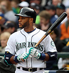 Seattle Mariners'  Robinson Cano warms up i the on deck circle before facing Los Angeles Angels' starting pitcher Jered Weaver in the third inning of  season home opener April 6, 2015 at Safeco Field in Seattle.  The Mariners beat the Angels 4-1.  Cano hit a RBI to  single to center field.    ©2015. Jim Bryant Photo. ALL RIGHTS RESERVED.