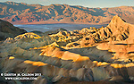 Winter sunrise at Zabriskie Point. Manly Beacon catches some major glow, with colorful eroded features surrounding, and views of Death Valley in background.