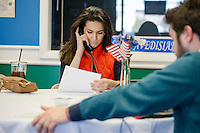 """Amos Rothstein (right), Rhode Island state director of the Kasich campaign, and Miss Rhode Island 2015 Alexandra Curtis, volunteering for the campaign, make """"get out the vote"""" phone calls from the campaign headquarters of mayor Scott Avedisian at the Airport Plaza strip mall in Warwick, Rhode Island, on Sun., Apr. 24, 2016. The campaign of Republican presidential candidate John Kasich has set up their state operations in the office. The Cruz and Trump campaigns also opened their state offices in the strip mall."""