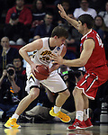 Davidson's Andrew McAuliffe (40) guards Iowa's Adam Woodbury (40) during 2015 NCAA Division I Men's Basketball Championship March 20, 2015 at the Key Arena in Seattle, Washington.  Iowa beat Davidson 83-52.   ©2015. Jim Bryant Photo. ALL RIGHTS RESERVED.