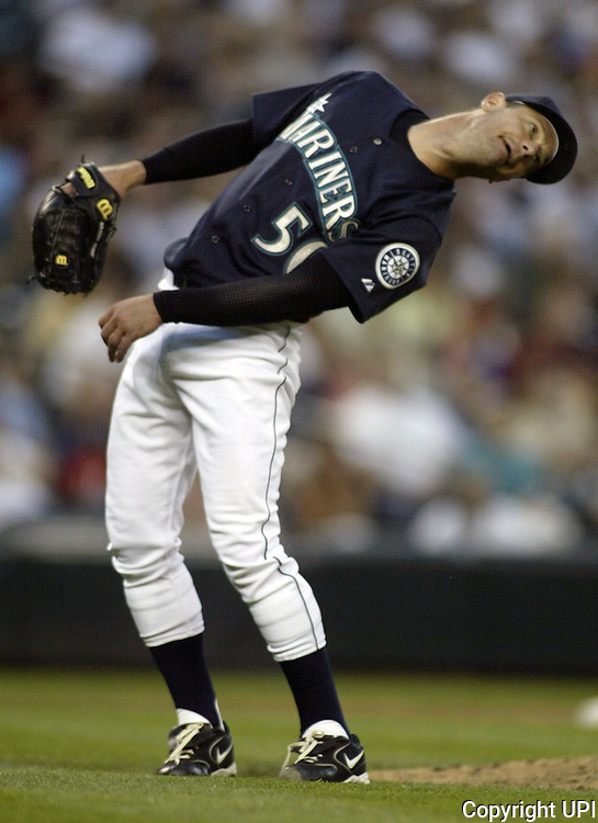 06/30/06 mariners 01 spts.Seattle Mariners' Jamie Moyer uses a little body english to help right fielder Ichiro Suzuki catch Colorado Rockies'  Ryan Spilborgh's pop fly in the ninth inning in Seattle on June 30, 2006. The Rockies beat the Mariners 2-0. Jim Bryant/PI Photo.