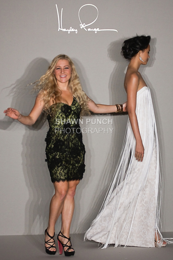 Bridal gown fashion designer Hayley Paige, poses with model on the runway, at the close of the Hayley Paige Spring 2012 Bridal collection, at the JLM Couture fashion show, during Bridal Week New York Spring 2012.