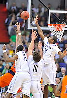 A Bison players is smothered by the Huskies' defense. Connecticut defeated Bucknell 81-52 during the NCAA tournament at the Verizon Center in Washington, D.C. on Thursday, March 17, 2011. Alan P. Santos/DC Sports Box