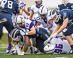 8 October 2016: Amherst College Purple & White Inside Linebacker John Callahan, a Sophomore from Bethlehem, PA, tackles Middlebury College Panther Running Back Diego Meritus, a Sophomore from Yarmouthport, MA, at Alumni Stadium in Middlebury, Vermont. The Panthers edged out the Purple & While 27-26. Mandatory Credit: Ed Wolfstein Photo *** RAW (NEF) Image File Available ***