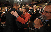 United States President Barack Obama embraces U.S. Representative Gabrielle Giffords (Democrat of Arizona) as members of Congress applaud before his his State of the Union address in fornt of a joint session of Congress on Tuesday, January 24, 2012 on Capitol Hill in Washington, DC. .Credit: Saul Loeb / Pool via CNP
