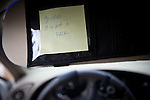 A reminder note from a veteran is on the visor of the VA car used for driving simulations to overcome problems associated with driving in Iraq or Afghanistan in Palo Alto, Calif., December 15, 2011.