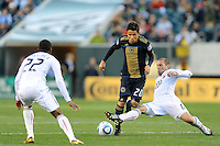 Kurt Morsink (6) of D. C. United goes for a tackle on Roger Torres (20) of the Philadelphia Union. The Philadelphia Union defeated D. C. United 3-2 during a Major League Soccer (MLS) match at Lincoln Financial Field in Philadelphia, PA, on April 10, 2010.